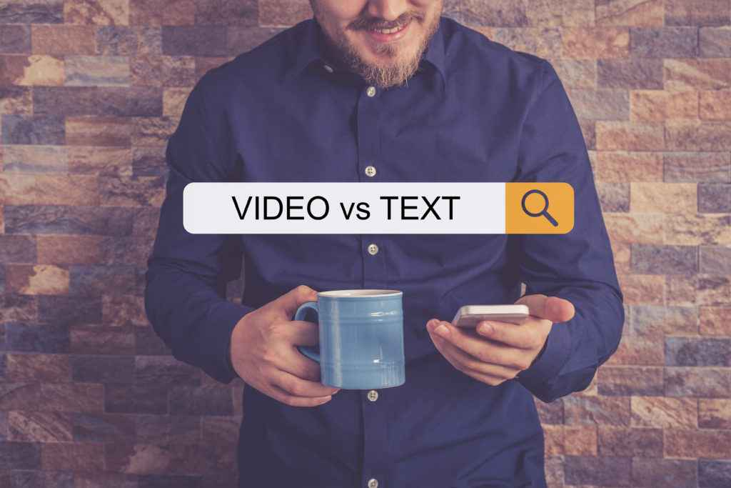 Man with a phone in the article Text Versus Video